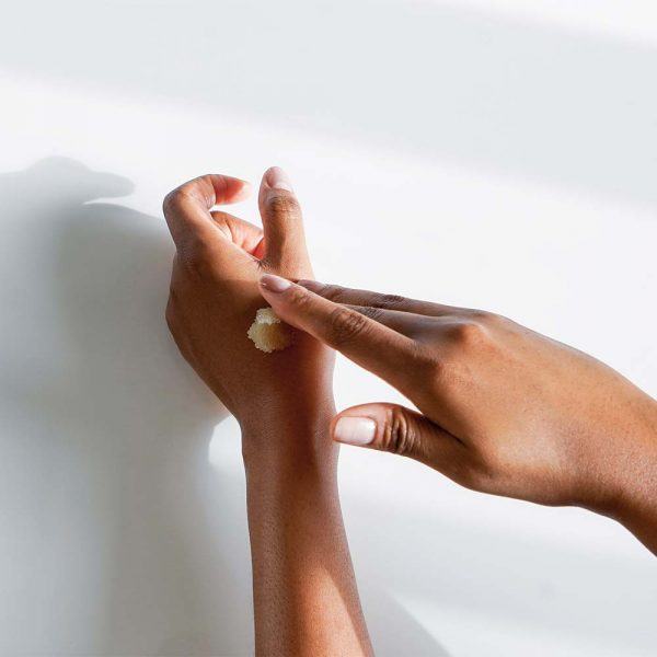 Malée Natural Science Verdure conditioning body scrub applied to the back of hand for smooth skin