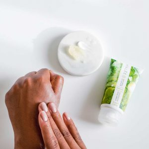 Malée Natural Science Verdure Nourishing hand cream for dry hands being applied to back of hands with finger tips